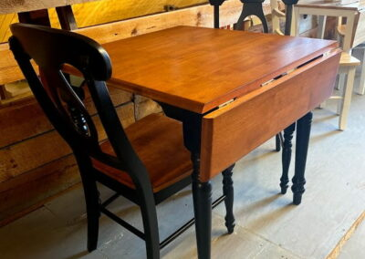 "Black & cherry rectangle drop leaf table 32""W X 42""D with open leaves and 2 napoleon side chairs"